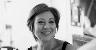 black and white image of a woman with short hair smiling