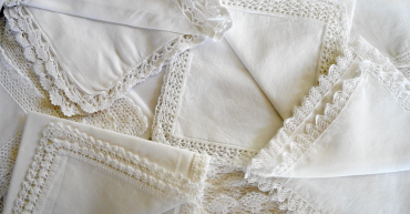 white linens with crocheted edges