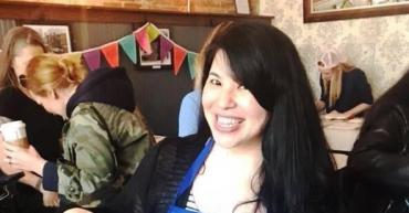 woman smiling wearing CraftJam apron